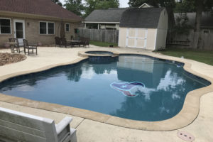 Swimming pool with a Houston Texans logo added to the bottom.