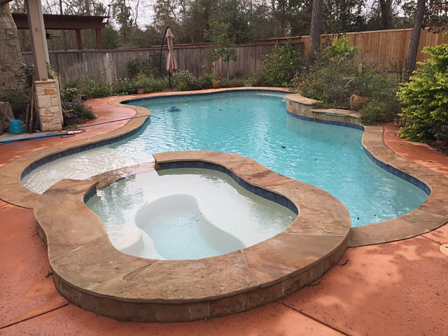 A pool and spa with a Tarricotta salt deck.