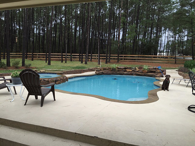 A showcase pool with a light-colored spray deck.