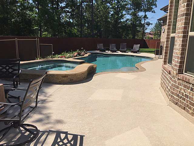 A showcase pool with a tan spray deck.