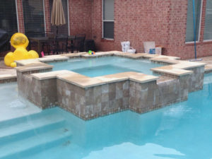 A hot tub with tile border in Humble.