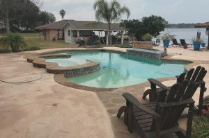 Completed pool in Montgomery, Texas with chairs and decking