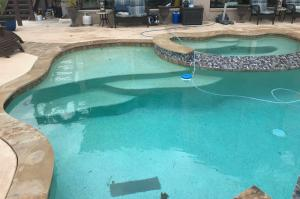 Completed pool in Montgomery, Texas with steps and hot tub.