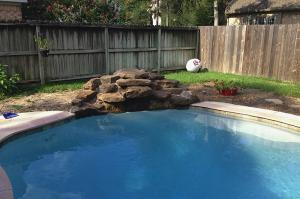 pool with rocks and aggies