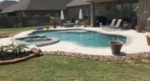 Completed pool in Tomball, Texas with decking and hot tub.